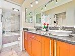 Master bath has full tub with shower and dual vanity designer basins.