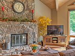 Cuddle up while watching TV in the living area as the stone fireplace warms the room.
