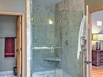 Rinse off in the master bathroom's exquisite walk-in shower.