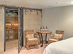 With a wine cellar and a lovely table, this bedroom offers the perfect opportunity for a night cap before drifting off...