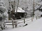 Beautiful fluffy mountain snow makes a winter wonderland here at Walnut Falls Cabin.