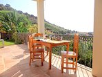 Terrace outside the kitchen with valley view