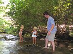 Kids and adults alike enjoy wading and playing in the cool, clear water just off the cabin porch