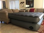 Living room bed height air mattress that slips into loveseat for sleeping for 2 more.