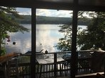 great views from the screened porch overlooking fire pit, deck and BBQ area