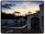 When sun sets, sky view from pool area.