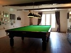 Large games room complete with professional full-sized billiard/pool table and darts board