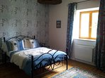 Oak beamed Bedroom 2. Spacious with double bed, wardrobe, TV/DVD player and en-suite shower room