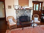 Sitting room with original fire place.