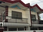 A  brand new 2 bedroom  at the city centre of Dumaguete  with a remote control air con 2 bathrooms
