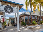 Sparky's Landing Restaurant offers the best Happy hour seafood and drinks.  Just a 3-4 minute walk.