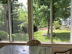 View from your second screened porch. It walks out to the garden and pond.
