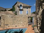 The stone house and private  pool in beautiful courtyard setting.