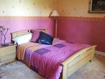 Oak beamed Bedroom 4. Spacious with double bed and large built-in wardrobes.