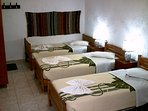 Triple bedded room with private facilities