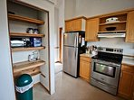 Upper level fully equipped kitchen with stainless steel appliances, toaster oven, breakfast bar for 2 and a door...
