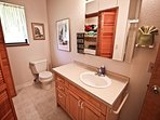 Lower level hall bathroom with a tub/shower combo and closet with washer/dryer