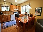 Fully equipped kitchen with all appliances, dining area for 5, CD player and an ocean view
