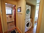 Master bedroom with a stackable washer/dryer