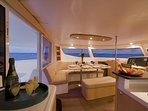 Galley dining seating for up to ten people with windows surrounding you, 360 degrees.