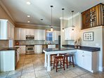 Kitchen Area feat. Stainless Steel Appliances, and Breakfast Bar