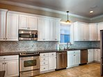 Kitchen Area feat. Stainless Steel Appliances, 2 Dishwashers, Double Fridge, and