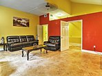 Spread out in the spacious living area featuring bright colors.