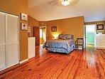 The master bedroom boasts beautiful hardwood floors and ample room.