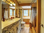 Rinse off in this pristine bathroom.