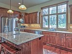 The gourmet kitchen features stainless steel appliances, granite counters and all the necessary cooking gadgets.