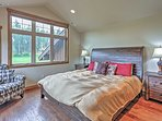 Enjoy gorgeous nature views from the expansive bedroom windows.
