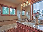 The stunning master bathroom offers a glorious soaking tub.
