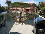Large newly extended deck overlooking canal with patio furniture & new gas grill
