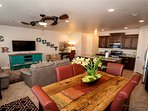 Large open concept kitchen and living area with large flatscreen smart tv