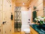 Full hall bath on main level.