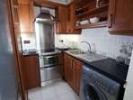 kitchen with cooker, double oven, washing machine, fridge/freezer. Microwave, toaster, kettle & iron