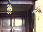 Front door with mobiles from around the world