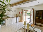 A large welcoming kitchen with a large table ready to socialise together !