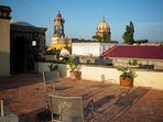 Roof Terrace, Monjas Church and monastery bell tower. Red roof is Angela Peralta Theatre