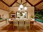 Dine poolside under soaring bamboo roof and exotic chandelier