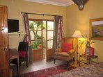 Guest bedrm:  French doors onto balcony over small courtyard.  TV, wifi, queen bed, desk w chair.