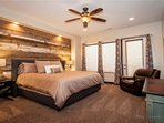 Beautiful master bedroom with King bed and large flat screen smart TV