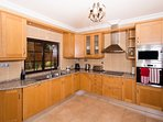 Fully fitted kitchen with separate utility room.
