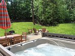Hot tub, fire pit and dinning table what more could you ask for