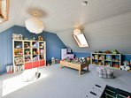Playroom with a  treasure trove of toys accessed via a 'secret' staircase.