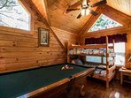 Guest Bedroom #1 features twin bunk bed, with pool table and games for the kids (or for you)!