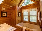Guest Bathroom features jacuzzi tub!
