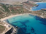 Ghajn Tuffieha Bay. One Of Malta's Most Beautiful Beach Just 10 Minutes By Bus.
