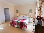 double bedroom with en-suite and garden views