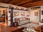 Navajo rugs, Hopi Kachina, Native American Art and local water colors breath artistry into our home.